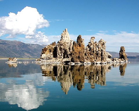 <b>ANCIENT ERUPTION:</b>  Limestone <i>tufas</i> protrude from Mono Lake creating mystical towers.