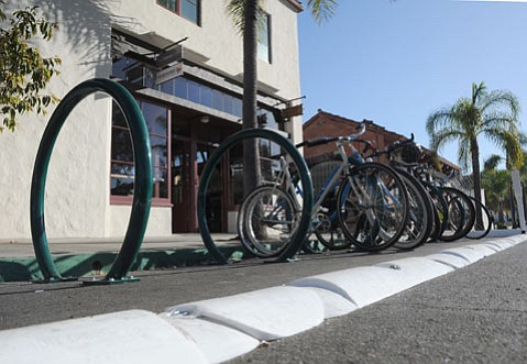"""Downtown Santa Barbara has its first """"bike corral"""" located on the bike-intensive stretch of East Canon Perdido Street by Jimmy's Oriental Gardens and the Three Pickles sandwich shop."""