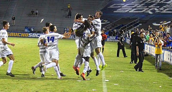 UCSB players mob Nick DePuy after his game-winning goal in the final seconds against UC Irvine.