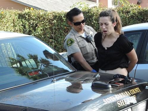 A Sheriff's deputy arrests Camilla DePerna
