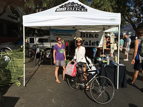 Free bike valet for cyclists at the Saturday Farmers Market on Cota Street.