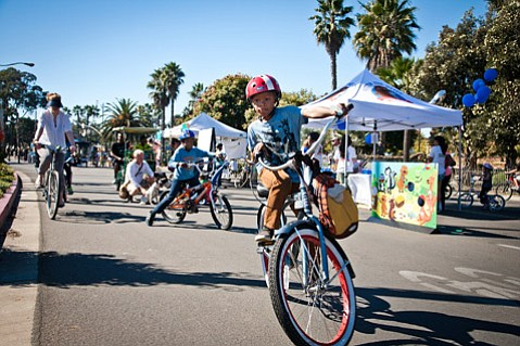 <b>WHEEL DEAL:</b>  Tikes, trikes, and bikes thronged Cabrillo Boulevard during last year's Open Streets celebration. Organizers have upped the ante for this Saturday's car-free extravaganza.