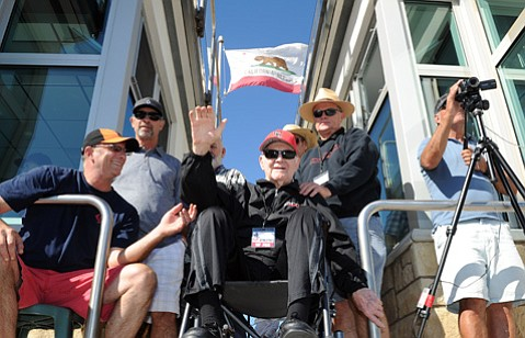 <b>ALL HAIL THE COACH:</b> Rusty Fairly (center) gives a wave to the Vaquero football team at last Saturday's game against L.A. Pierce College. Fairly coached SBCC baseball for 17 years, leading them to win the Western State Conference title in 1972.