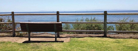 <b>FENCING COMING: </b> The approved barricade will closely resemble the fencing installed at Lookout Park in Summerland (shown here), although the Isla Vista fencing will have the chain link material extend to the top of the wooden posts to prevent people from sitting on it.