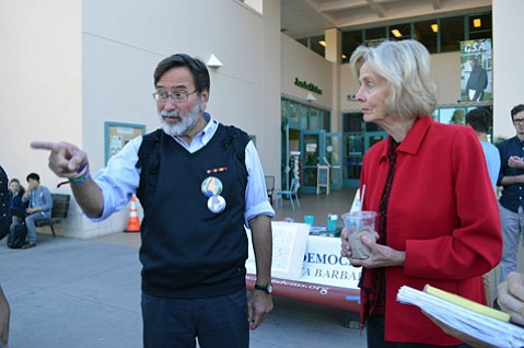 Richard Martinez (left) and Representative Lois Capps speak to UCSB students about the importance of voting.