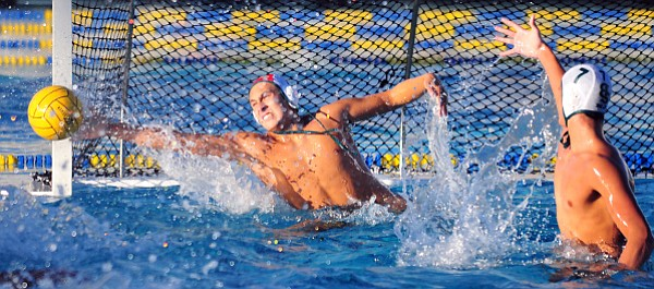 Santa Barbara High goalie Justyn Barrios makes one of his nine saves, including a blocked penalty shot.