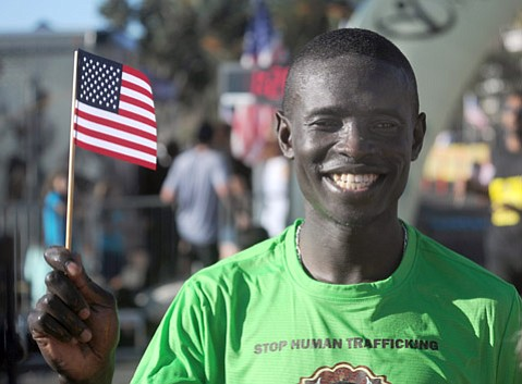 <b>MAN ON A MISSION:</b>  Moninda Marube dominated the half marathon last Saturday, finishing the 13.1-mile race more than two minutes ahead of the second-place runner. The Kenya native came not only to run but also to gain support for the 3,700-mile run across the U.S. he intends to start next spring on the coast of Maine and finish at Leadbetter Beach on November 7, 2015, at the end of another Santa Barbara Marathon.