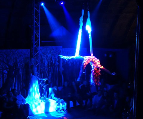 <b>LIGHTS OUT: </b> (top) Aerialists and drummers are just some of the elements in this unpredictable new show.