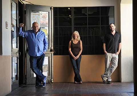 <b>FAMILY MATTERS:</b> SOhO owners Bob and Gail Hansen with their son, Tyler. In true family business fashion, three out of four of the Hansen children have worked at the restaurant/music venue over the course of its 20-year-long run.