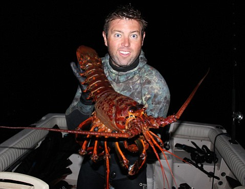 Forrest Galante proudly shows off his new buddy, a spiny lobster he caught and named Albert Girther