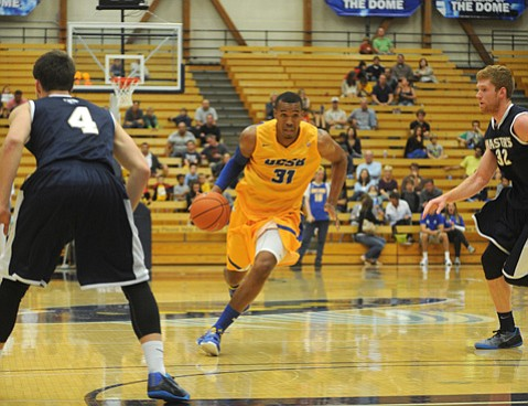 <b>THEY'RE BACK:</b>  UCSB's John Green (#31) made his college debut in a 2011 exhibition, but a cascade of injuries ended his freshman and sophomore seasons. Now he's back and looking forward to a big year.
