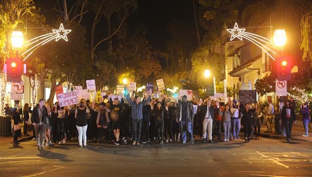 Demonstrators rally against the Ferguson Grand Jury decision