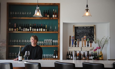 <b>WINE GUY WITH BEER:</b>  After years of running his still-thriving bottle shop Vino Divino, Sean Larkins is now serving rare beers, food, and, yes, still wine (like this lovely Samsara he's drinking) at his new Villa Wine Bar & Kitchen on Anacapa Street downtown.