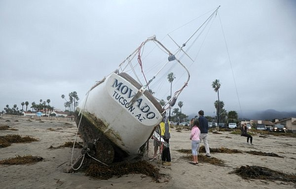 A stranded boat is used as a swing on East Beach (March 1, 2014)