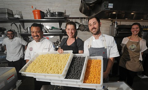 <b>NOODLE KNOWLEDGE:</b>  Owner Diane Harding (center) brings Italian flare to the Public Market with help from Chef Brian Dodero (right) and Catalino (left).