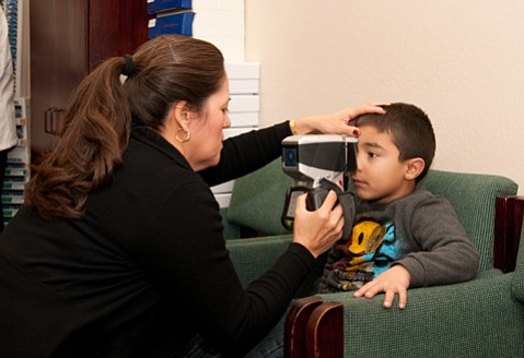 A Kids Day participant gets a free eye exam.