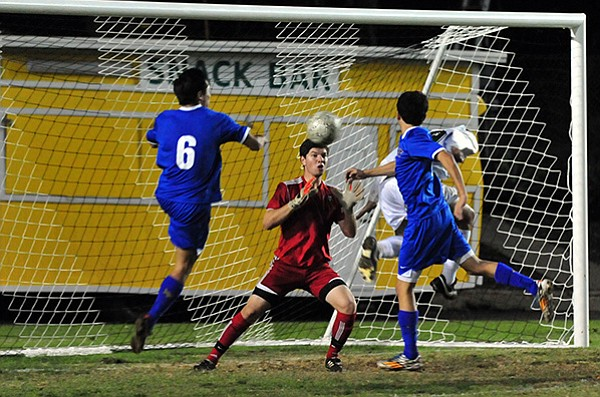 Carlos Hernandez (#19, in white) gets behind the defense but can't put his header past the Arroyo Grande goalkeeper during the first half.