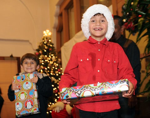 Kids receive presents at this year's Police Activities League holiday dinner
