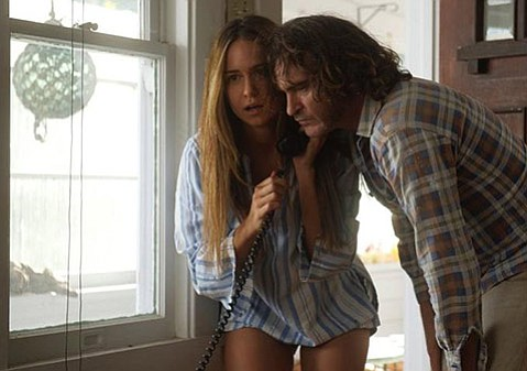 <b>WHAT'S UP, DOC? </b> Based on Thomas Pynchon's novel, Paul Thomas Anderson's <i>Inherent Vice</i> stars Joaquin Phoenix as pothead PI Doc Sportello alongside lady friends played by Reese Withersoon (above) and Katherine Waterston (below).