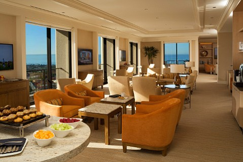 A lounge atop the 20-story Island Hotel shows views across Newport Beach's coastline and harbor.