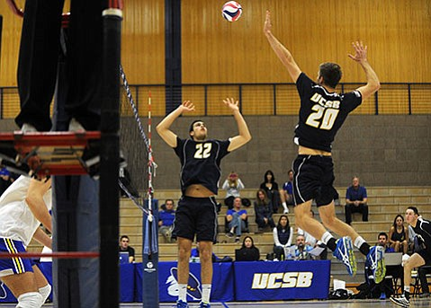 VOLLEYBALL GODS:  UCSB's All-American setter Jonah Seif (#22) puts up a ball fit for a killing by hitter Ryan Hardy (#20) during a Gaucho sweep of the Limestone South Carolina Saints in tournament action last week.