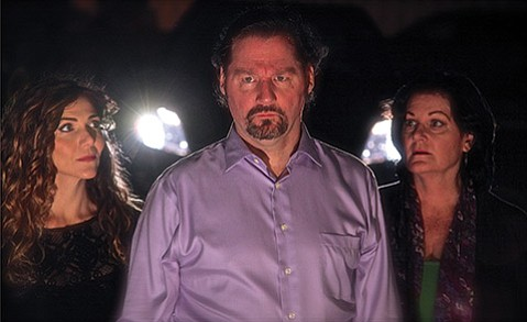 MAN IN THE MIDDLE:  Top: An intense Bill Egan is flanked by Ivy Vahanian (left) and Leslie Story (right).