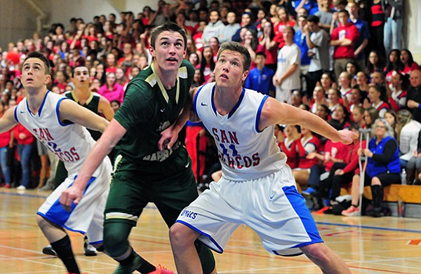 Bolden Brace of Santa Barbara and San Marcos' Scott Everman battle for rebounding position.
