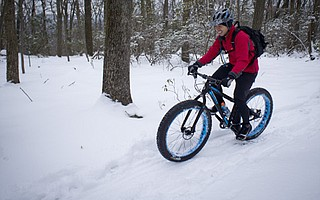 Jericho Estella plows through winter snow in Frederick Maryland.