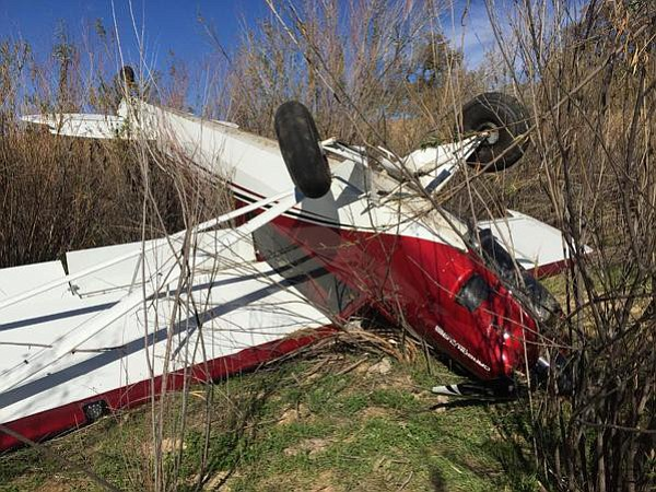 TOPPLED, BUT SAFE:  Aircraft flipped during emergency landing on Highway 166. Pilot and passenger walked away.