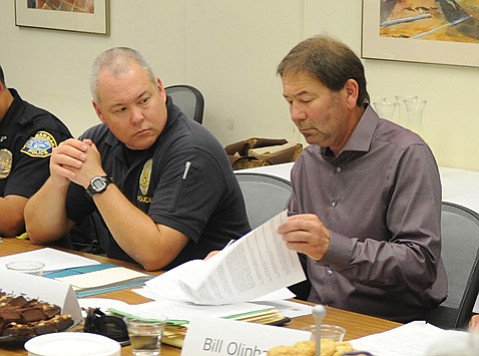 <b>NOT SOLD:</b>  Sgt. Riley Harwood (left), sitting next to Mark Taylor, expressed concern that a one-size-fits-all noise ordinance could engender political blowback.