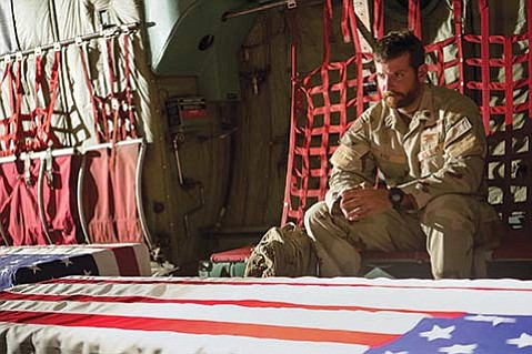 COMBAT FATIGUE:  Bradley Cooper plays real-life Navy SEAL Chris Kyle in director Clint Eastwood's American Sniper.