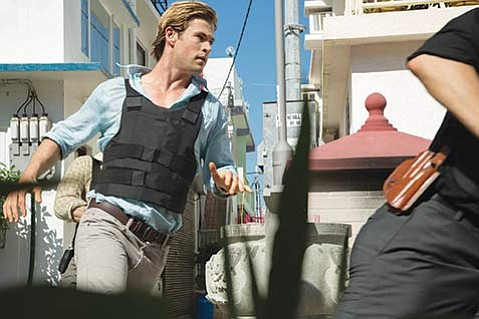 LEAVE YOUR HAT ON:  Blackhat stars Chris Hemsworth as a furloughed convict and hacker on the hunt for a high-level cybercrime network.