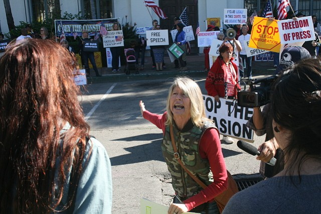 News-Press supporter Mona Hansen spars with protestors