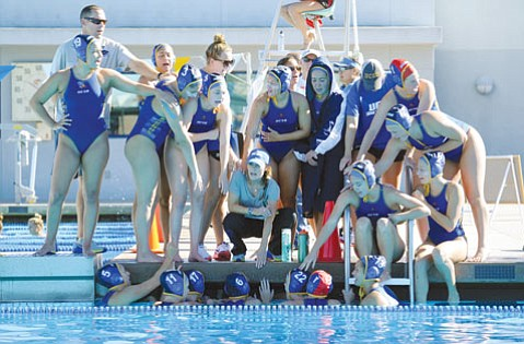 """<b>POOLSIDE PLANS:</b> """"I want us to have a championship mind-set and be able to win the Big West Conference,"""" said UCSB head coach Serela Kay, who feels optimistic about the team's future. """"We have a lot of time to improve. We're going to be a different team in 12 weeks."""" Kay (center) squats, surrounded by her water polo players."""