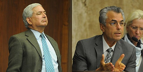 <b>Tough Talk:</b>  Water commissioner Russell Ruiz (left) faulted Jeff Young for his vote to impose tougher regulations on the desal plant.