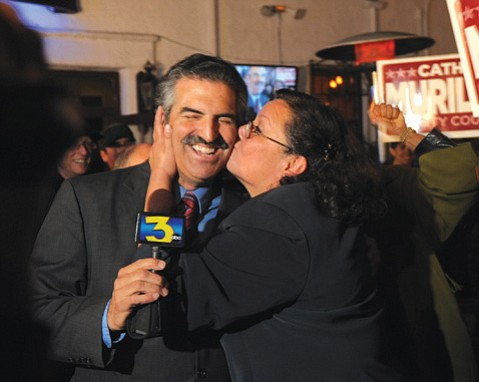 City Councilmember Cathy Murillo smooches John Palminteri at an election night party