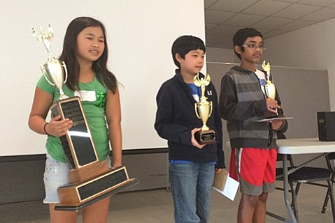 Elementary winners, from left to right: Camille Cheng, Wesley Lin, and Srikar Mandineni