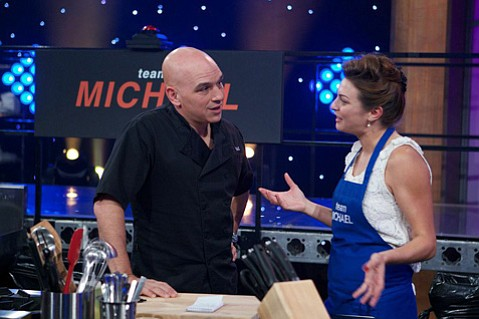 Santa Barbara chef Vanessa Craig (right) with her mentor Michael Symon on the Food Network show <em>All-Star Academy</em>