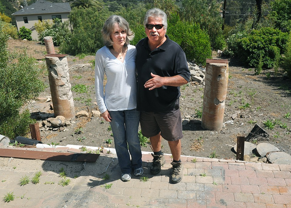 Pamela and Ruben Barajas at the site where their home burned in the Tea Fire and has yet to be rebuilt due to legal battles with the City over the argument of being in a slide area. (Mar. 31, 2015)