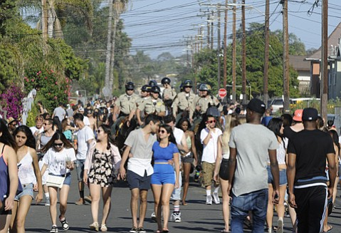 <b>RIDING HIGH: </b> The Isla Vista Foot Patrol kept things relatively calm during this year's Deltopia.