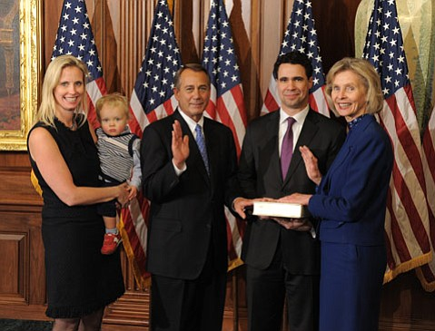 Laura Capps (far left) attends the swearing in ceremony of her mother, Rep. Lois Capps, in 2013