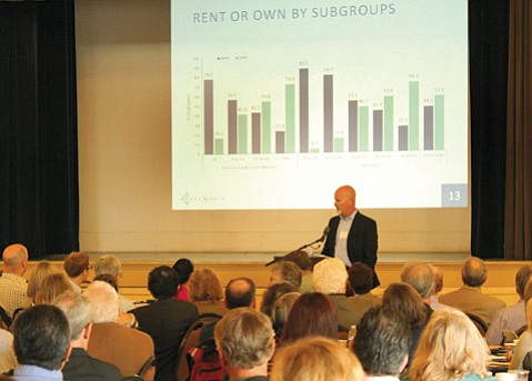 <b>NUMBERS DON'T LIE:</b>  Dr. Tim McLarney spoke to a packed house of planners, politicians, developers, and business owners.