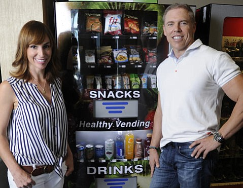 <b>AUTOMATICALLY AWESOME:</b> Angela Cosentino and Chuck Stumpf's vending machines show quick snacks can be good for you.