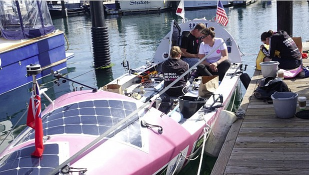 The Coxless Crew repairs its boat in the Santa Barbara Harbor.