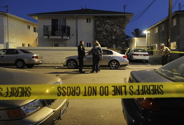 Police section off most of a block in Isla Vista while investigating a shooting at 6515 Sabado Tarde that sent three people to the hospital. (May 11, 2015) .