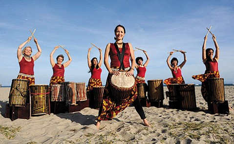 <b>DRAWN TO THE RHYTHM:</b>  Lisa Beck (center) and the Djun Djun Mamas evoke a powerful experience with their combination of West African drumming and dance.