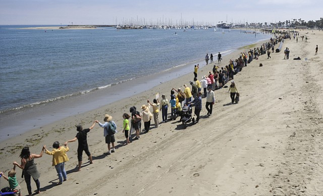 Stand in the Sand rally had hundreds gathered at De La Guerra Park to protest the Plains All American oil spill then march down State Street to the beach. (May 31, 2015)