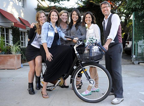 <b>Pedal Power:</b>  Sonos staffers (from left) Libby, Melissa, Allison, and Alejandra received CycleMAYnia's 2015 Bicycle Friendly Business Award from Lori and Kent with Traffic Solutions.