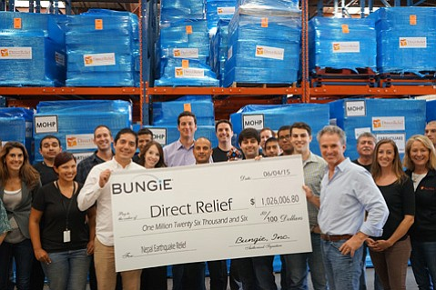 (From left to right) Santa Barbara-based Bungie gamers Eddie Moreno, Raul Aguirre, and Ian Clark present the check for more than $1 million to Direct Relief CEO Thomas Tighe
