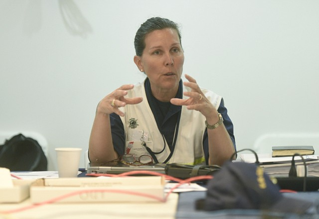 U.S. Coast Guard Capt. Jennifer Williams at the Joint Incident Command Center for the Plains All American Refugio Beach Oil Spill. (June 11, 2015)